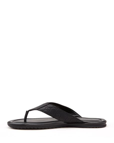 6005fdb49e0 Gucci Rubberized Leather Thong Sandal