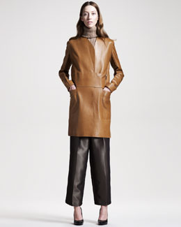 THE ROW Long Leather Coat, Sleeveless Turtleneck Sweater & Metallic(Bronze) Wide-Leg Pants